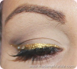 gold eyeliner with rhinestones