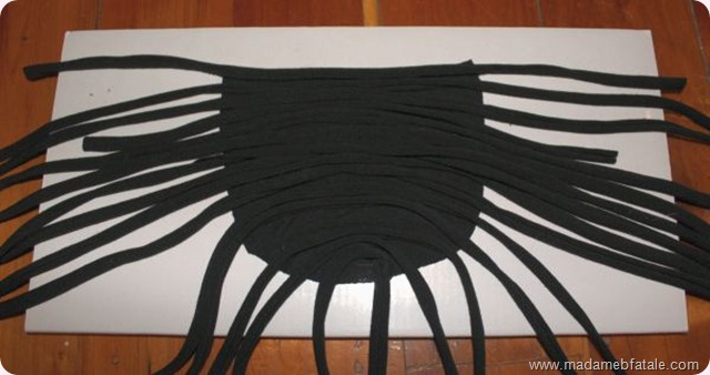 arrange strips of stretched fabric on shoulder pads arrange them the same on each pad